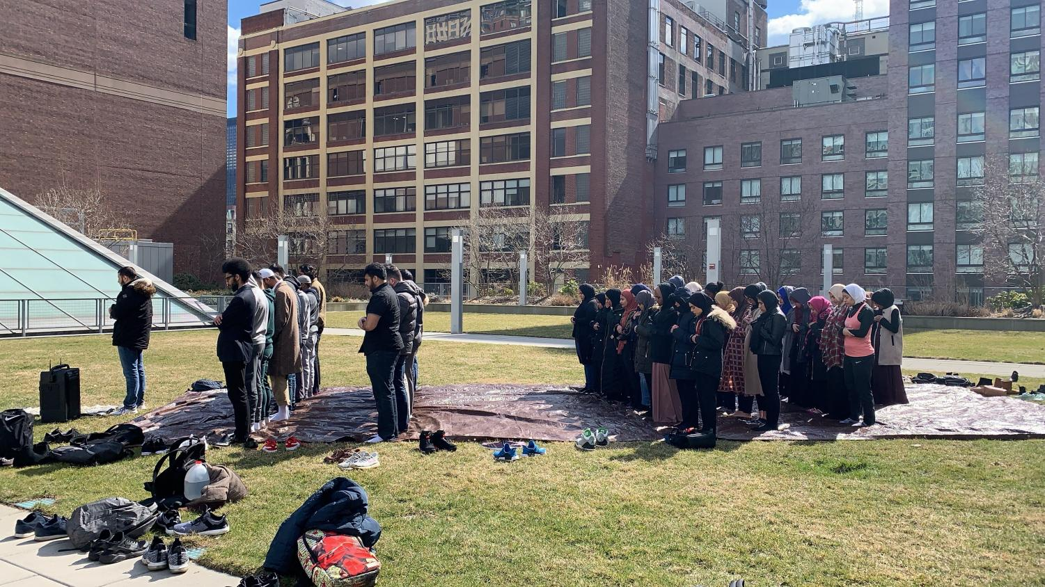 Muslim students during Dhuhr prayer, a noon prayer on the Jay Walk by Nora Abuhamdeh