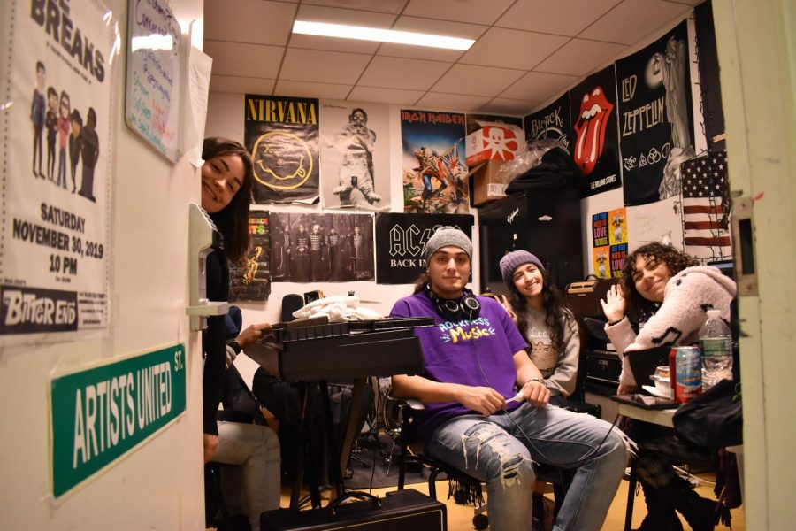 Students, part of the Artists United Club, in their club room.