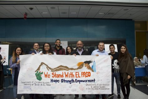 Students and faculty stand with the solidarity El Paso poster in the Atrium - Damba Yansane